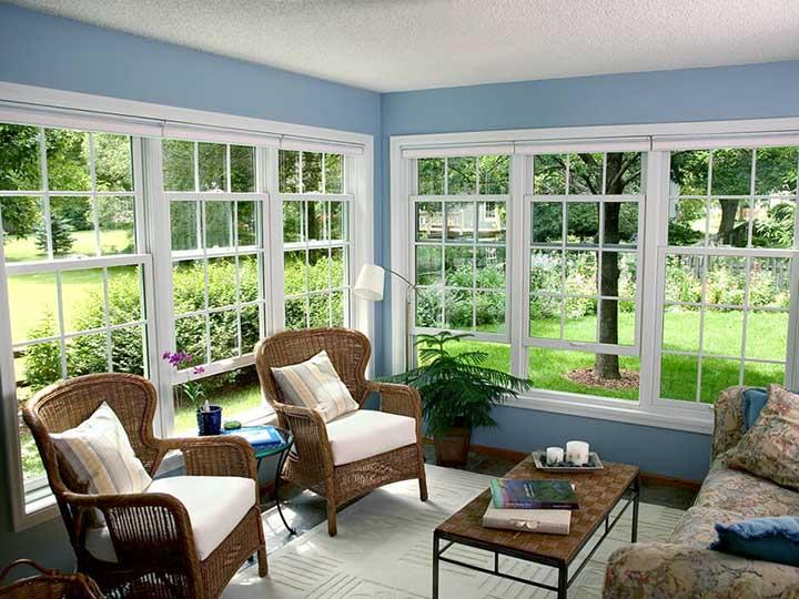 White cottage-style double hung windows