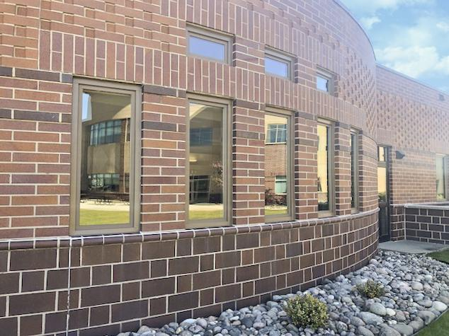 Exterior shot of brick building with multiple Renewal by Andersen windows